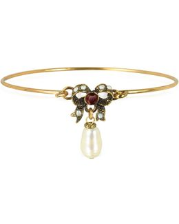 Happiness Goldtone Brass Bow And Glass Pearl Bangle