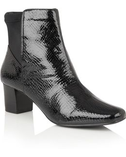 Swallow Animal Print Ankle Boots