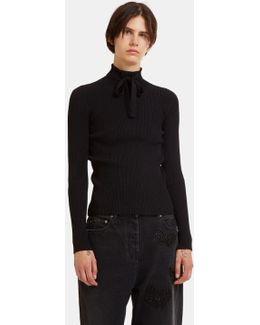 Ribbon Tied Ribbed Roll Neck Sweater In Black