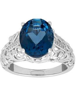 Blue Topaz And 0.066 Tcw Diamond Silver Oval Ring