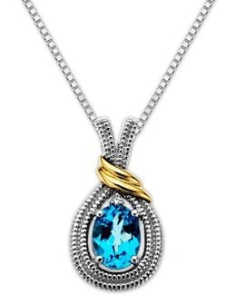 Sterling Silver Necklace With 14kt. Yellow Gold Blue Topaz And Diamond Pendant