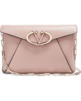 V Rivet Leather Clutch Bag