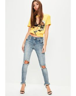 Blue Anarchy Mid Rise Busted Knee Skinny Jeans