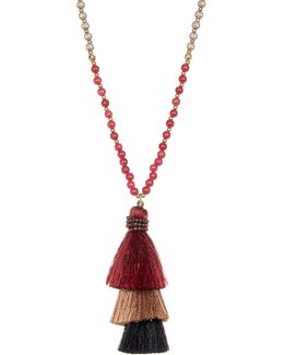 Long Beaded Necklace With Stacked Tassel Pendant
