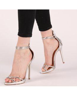 Eloise Cross Over Strap Stiletto Heels In Gold
