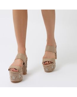 Rogue Patent Star Platform Block Heel Mules In Nude Faux Suede