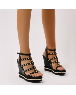 Sally Gladiator Studded Wedges In Black And Gold