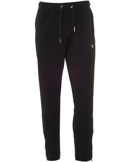 Black Trackpants, Cuffed Gold Metal Horseshoe Logo Sweatpants