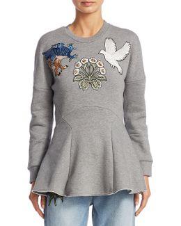 Medieval Embroidered Peplum Sweater