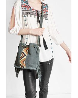 Embroidered Suede Bucket Bag With Tassels