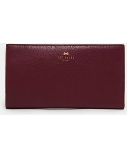 Bow Embossed Leather Travel Wallet
