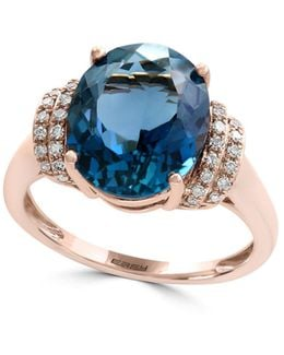 14k Rose Gold Blue Topaz And 0.12tcw Diamond Ring