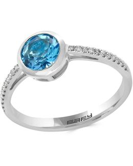 14k White Gold Blue Topaz And 0.08tcw Diamond Ring