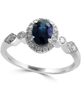 14k White Gold And Sapphire Halo Ring With 0.25 Tcw Diamonds