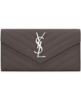 Large Monogram Flap Wallet In Earth Grain De Poudre Matelassé Leather