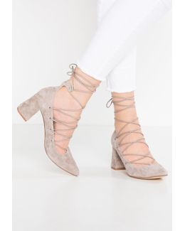 Odella Lace-up Heels