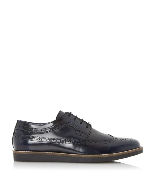 dune blackout wedge sole longwing brogue shoes in blue for