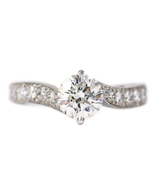 Van Cleef & Arpels Metallic Gia Certified Diamond Solitaire Bypass Ring In Platinum