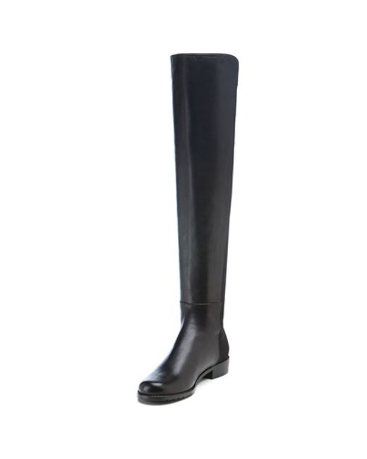 stuart weitzman knee length flat boots in black black