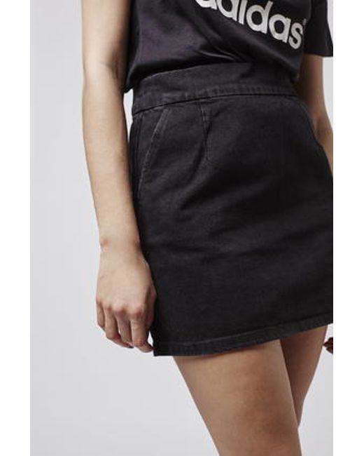 topshop moto clean cut denim mini skirt in black lyst