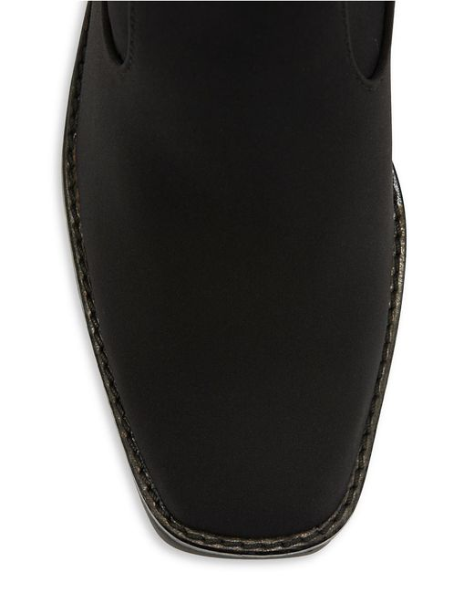 donald j pliner dahlia wedge boots in black lyst