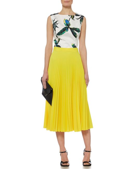 linea pleated midi skirt in yellow save 31 lyst