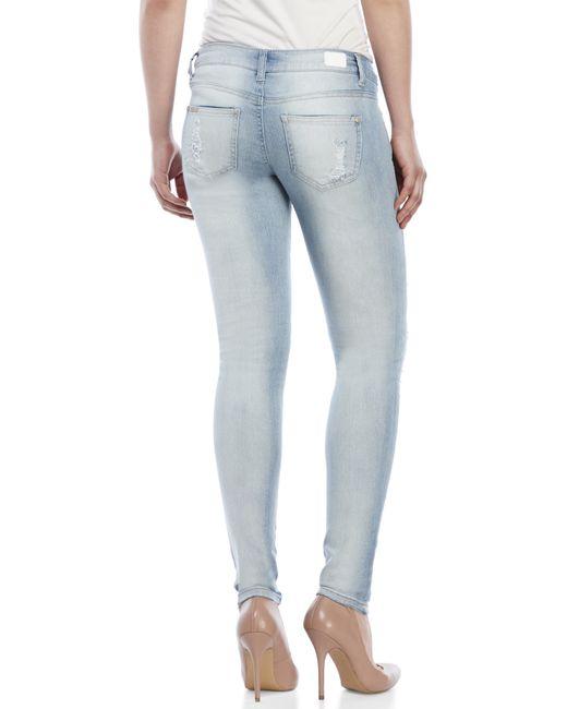 celebrity pink distressed skinny jeans in blue light wash