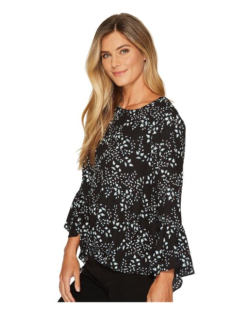ec6773b108e24 ... Vince Camuto - Black Cascading Leaves Flare Cuff Fold-over Blouse - Lyst  ...