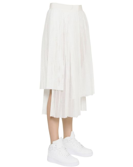 aviu laser cut pleated faux leather skirt in white lyst