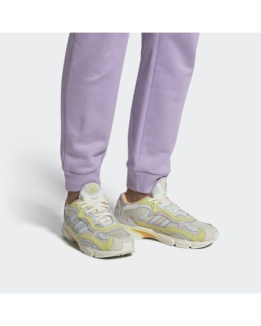 https://cdna.lystit.com/520/650/n/photos/adidas/a51e866c/adidas-White-Temper-Run-Pride-Shoes.jpeg