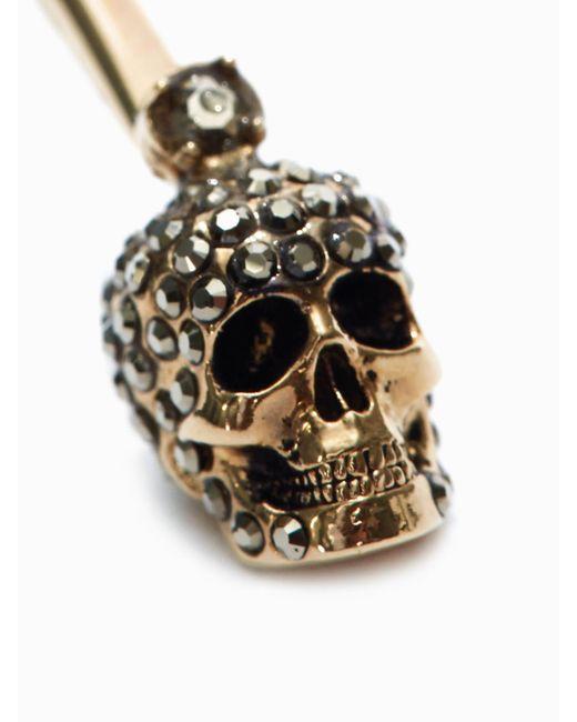 Alexander McQueen Stick Skull Earrings Metallic
