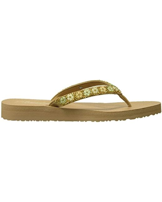 4345c4881433 Lyst - Skechers Meditation-daisy Delight Flip-flop in Natural - Save 70%