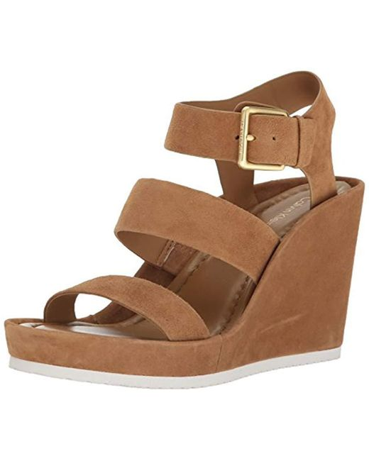 1ec13f3c4787 Lyst - Calvin Klein Hailey Wedge Sandal in Brown - Save 54%