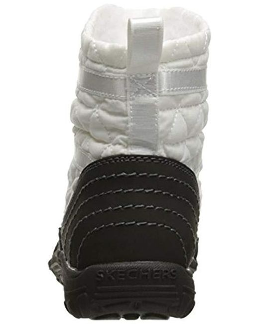 f589e92941a98 ... Skechers - Black Reggae Fest Steady Quilted Bungee Ankle Bootie - Lyst  ...