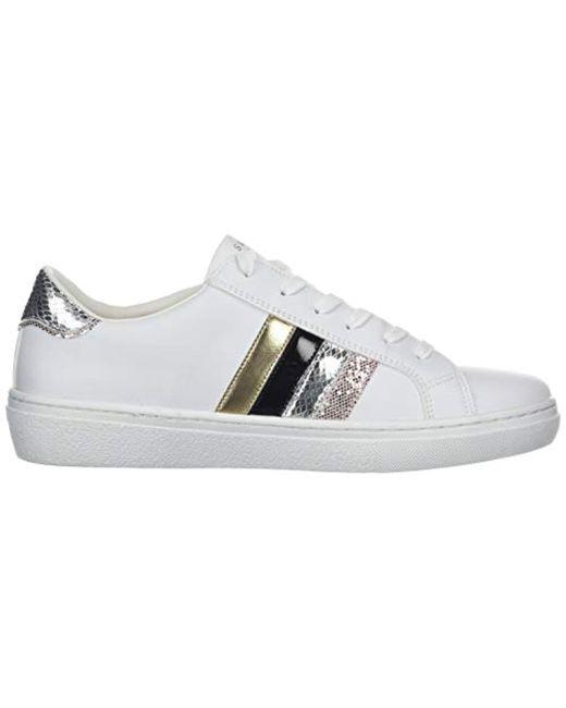 Women's White Goldie peaks. Pyramid Stud Collar Sneaker