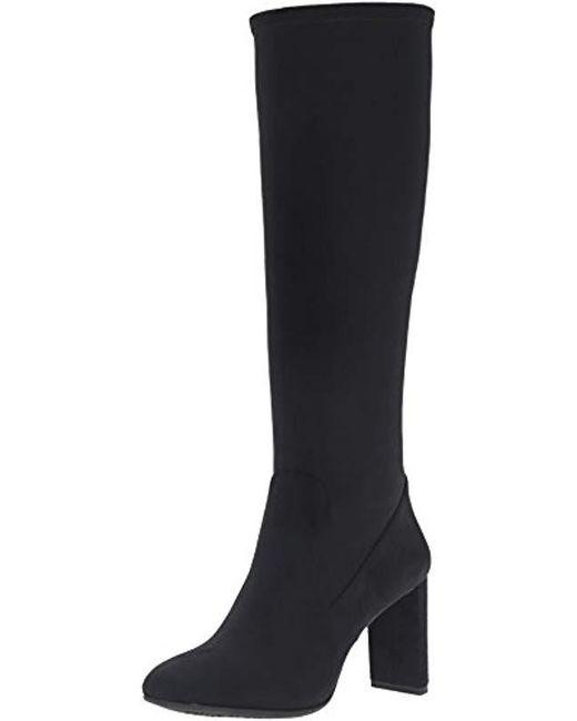 1f9ae38383 Lyst - Nine West Kellan Fabric Winter Boot in Black - Save 15%