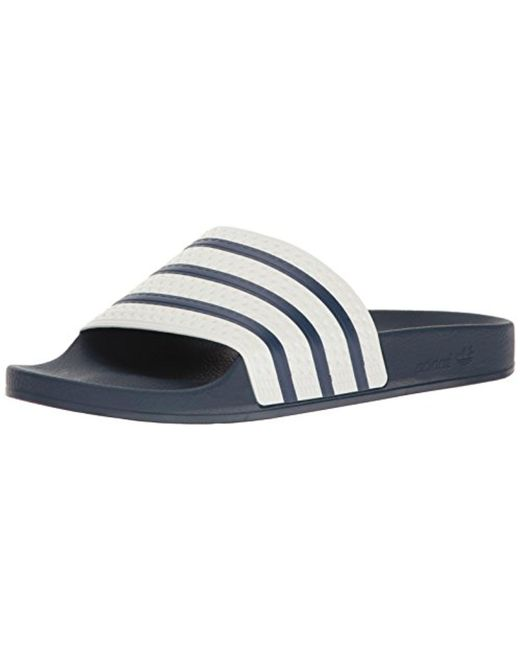 e1c57f12034e3 Adidas Originals - Blue Adilette Slide Sandal - Lyst ...