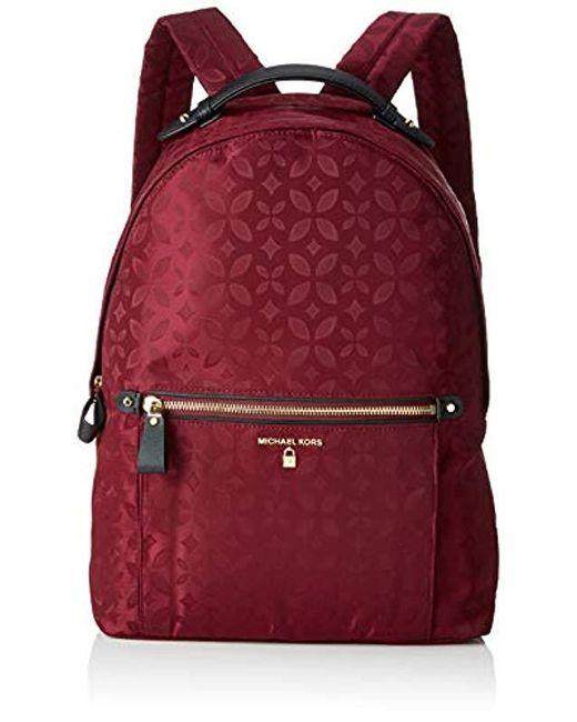 52997ba1d07d Michael Kors Nylon Kelsey Backpack Handbag in Purple - Save 49% - Lyst