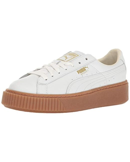 Lyst - PUMA Basket Platform Core Women s Sneakers in White - Save 61% 9693454ee
