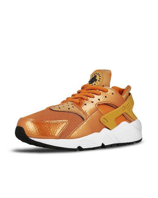 634835-701 - Age Nike en coloris Orange