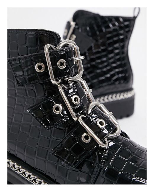 Bottes à boucles et chaîne style militaire Truffle Collection en coloris Black