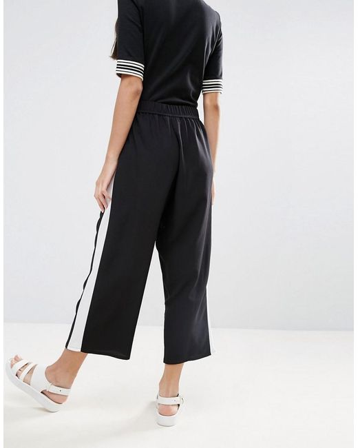 For a timeless look, slip on high-waist sailor-style wide leg pants with a tucked-in striped tee and cute ballet flats. Or, keep it quirky in a pair of brightly colored wide leg pants with a printed bow-neck blouse, polka dot cardi, and platform heels!