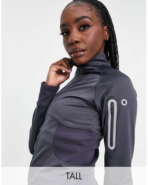 Chaqueta para correr con aberturas para los pulgares y bolsillo para el teléfono ASOS 4505 de color Gray