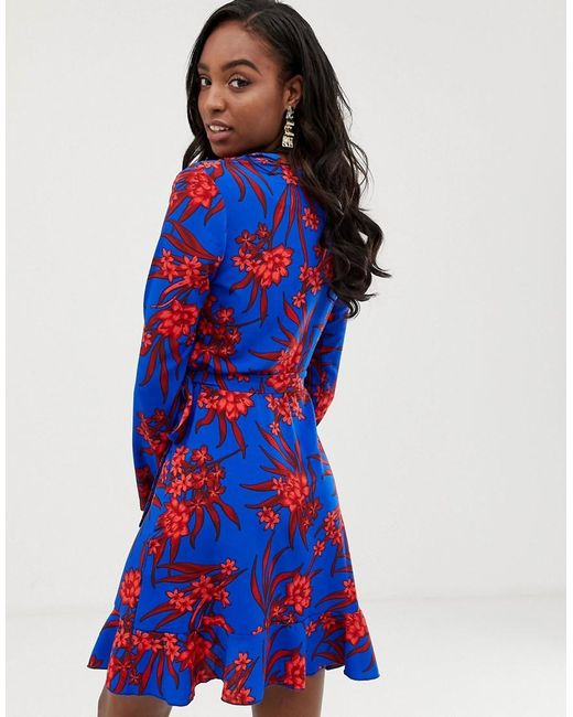 9975a3dbf0 ... John Zack - Blue Ruffle Wrap Front Tea Dress In Red Floral Print - Lyst