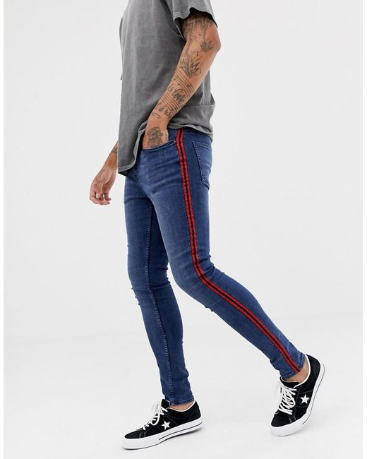 15d7c4719932 ... New Look - Skinny Jeans With Red Side Stripe In Blue Wash for Men - Lyst