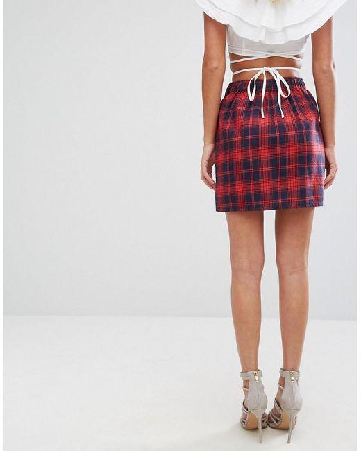 3abd094dcc8b52 Mini-jupe à carreaux avec lien à nouer sur le devant femme de coloris rouge