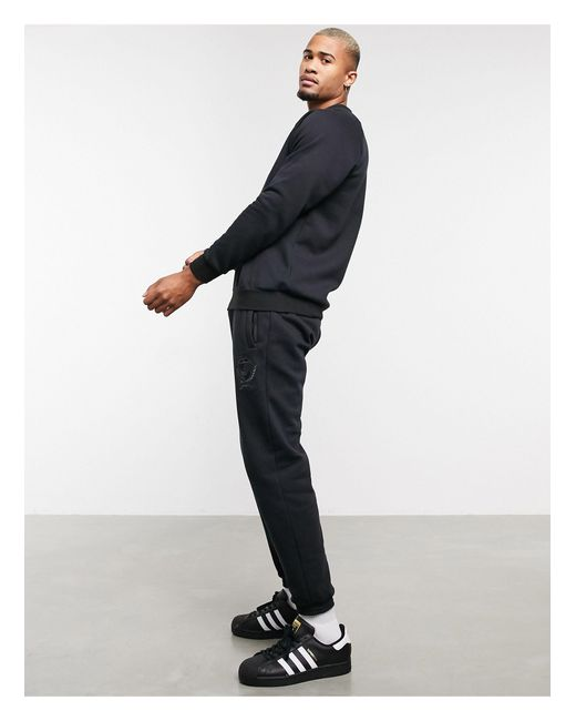 Adidas Originals Black Co-ord joggers With Collegiate Crest for men
