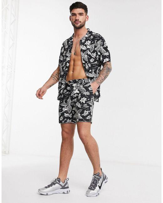 Pantalones cortos con estampado hawaiano en negro Bellfield de hombre de color Black