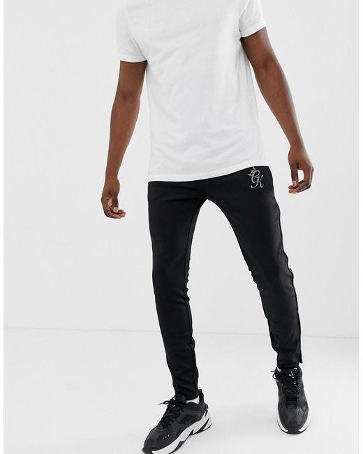 abc8e15a0 Gym King - Black Pantalones de chndal negros de polister con diseo  reflectante Freeman de for ...