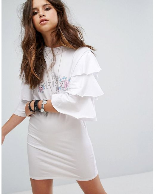 Prettylittlething frill sleeve t shirt dress in white lyst for Frill sleeve t shirt